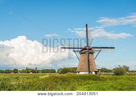 Eight-sided thatched historic windmill De Oude Doorn near the Dutch village of Almkerk was built around 1700 and restored in 2012. The wooden mill on a high brick base now has no role in the drainage of the polder Den Doorn.