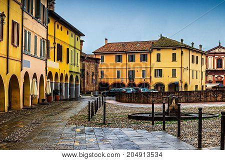 Houses And Well On The Square In The Medieval Fontanellato