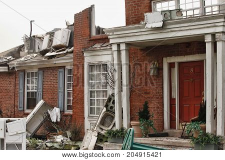 Red brick house damaged by a natural disaster. Scenery for cinema