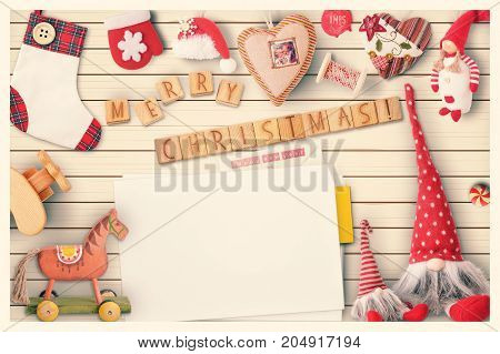 Christmas Greeting Card with Xmas Elements on White Wooden Background. Retro Style. Space for Text. Vintage Toned.