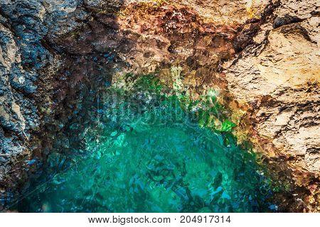 Rocky coast and transparent sea. Nature background