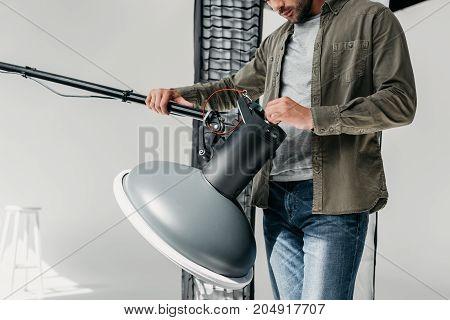 Photographer With Lighting Equipment