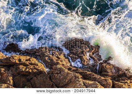 Rocky coast line and sea waves. Nature
