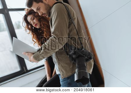 Photographer And Model With Laptop