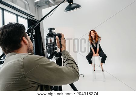 Photographer And Model On Fashion Shoot