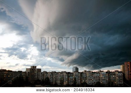 Heavy rain clouds over the city. Stormy sky over the buildings. Typical modern residential district. Kiev, Ukraine