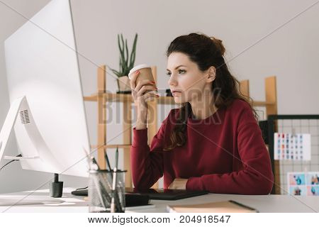 Designer With Coffee Working In Office