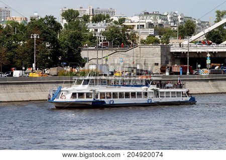 White Pleasure Boat Sails Along The Moscow River.
