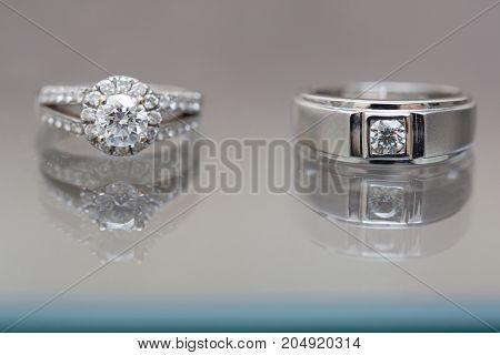 two wedding ring on mirror - Stock Image