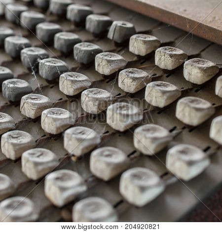 Details of an old keyboard on industrial machine of the late nineteenth century.