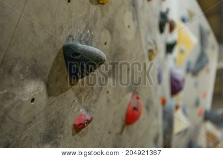 Grips On Climbing Wall
