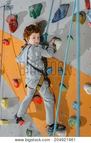 Little Boy Climbing Wall With Grips