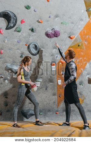 Young Man Pointing To Climbing Wall