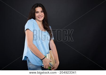 Cheerful Student Girl With A Pile Of Books
