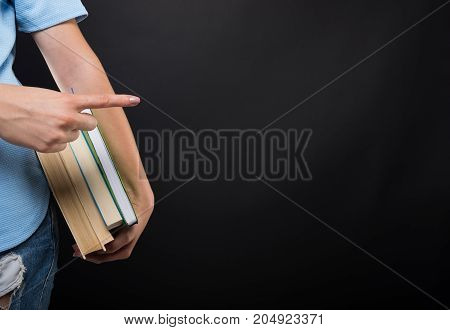 Closeup View Of Student Female Holding Books