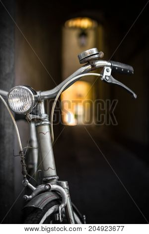 An old bicycle leaning against a wall.