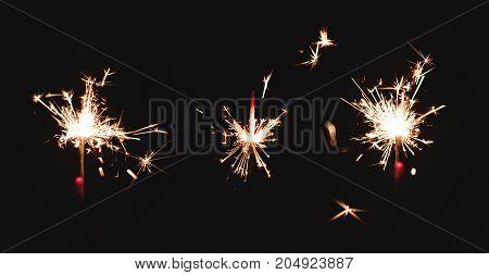 Three Sparkler firework light glowing in the dark