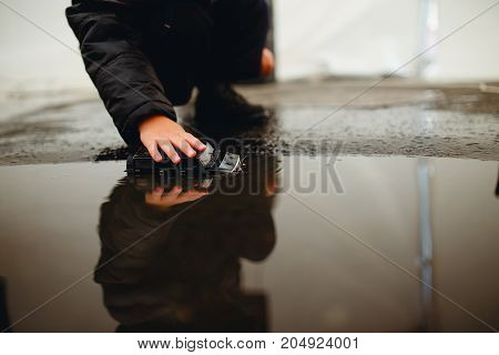 Houston, Texas - August 27, 2017: child plays with toys in a puddle of water. Heavy rains from hurricane Harvey.