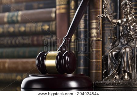 Law theme. Mallet of the judge. Books. Scale of justice, statue of justice.