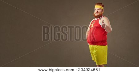 A fat man with a beard in a tracksuit. Comical in sport.