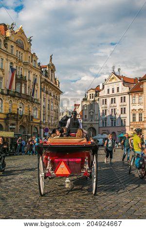 PRAGUE, CZECH REPUBLIC - AUGUST 16, 2017: Walking horse carriage in Old Town Square in Prague, Czech Republic