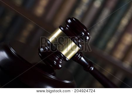Gavel of the jugde in the court library. Wooden desk.