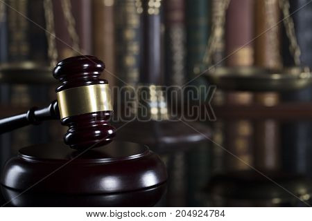 Gavel of the jugde and scale of justice in the court library.