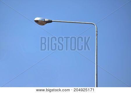 Street lamp post electricity industry with blue sky background