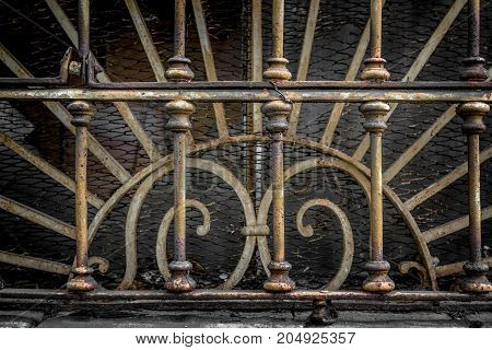 Decorations end 800 of an old Italian industrial railing.