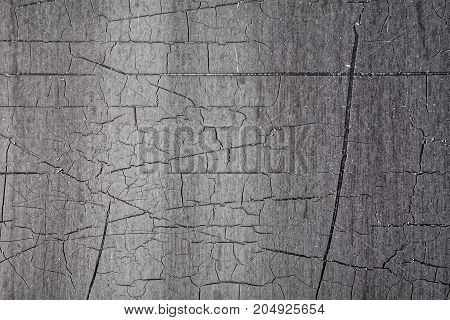 Black background texture of tar and dirty and scratched resin.
