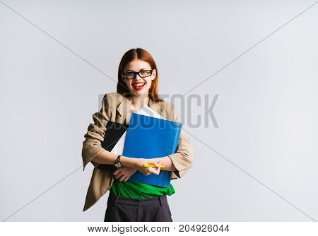 Happy successful young woman female student with documents and folders in hands smiling