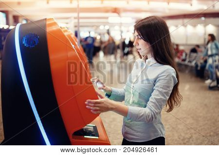 Closeup Girl self check flight or buying airplane tickets airport