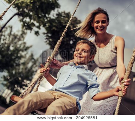 Mom With Son On Swing