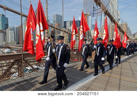 New York City, Usa, September 11, 2017 : Firemen Of New-york Walk On Brooklyn Bridge During Memorial