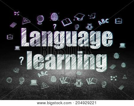 Education concept: Glowing text Language Learning,  Hand Drawn Education Icons in grunge dark room with Dirty Floor, black background