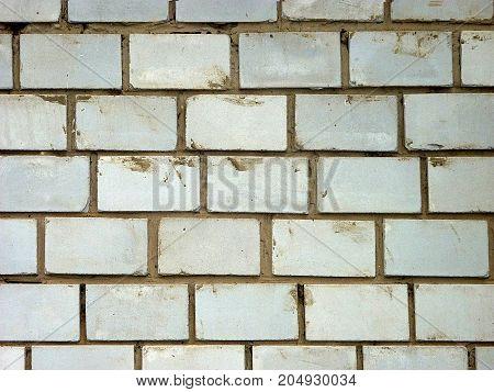 White brick wall background texture the seam