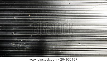 Metal profile, metal section, metal texture. Corrugated metal. Abstract grunge background