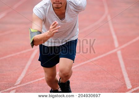 Runner athelete man running on the trackrace . Jogging for healthy concept