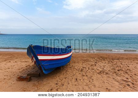 moroccan traditional fishing boat on the beach