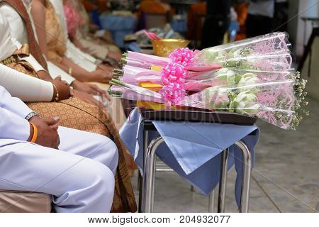 Bouquet of white lotus flowers for worship on the desk in the temple