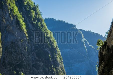 The sun shines through the gorge in the mountains