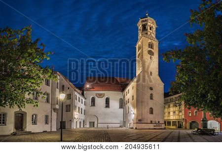 The former church of St. Peter and Paul also called Kreuzherrenkirche at dusk in Memmingen Bavaria