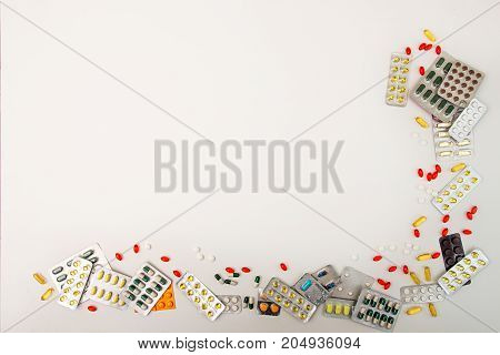 Pills Background. Heap Of Medicine Tablets And Pills In Blisters Different Colors On White Backgroun