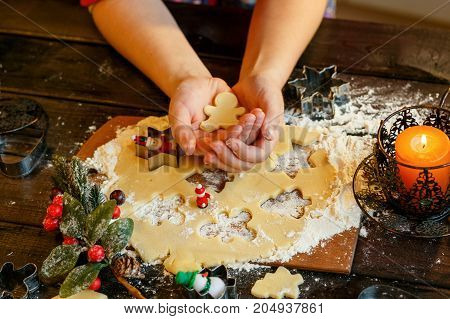 Christmas cookies. Snowmen, fir branch, the hand of a child