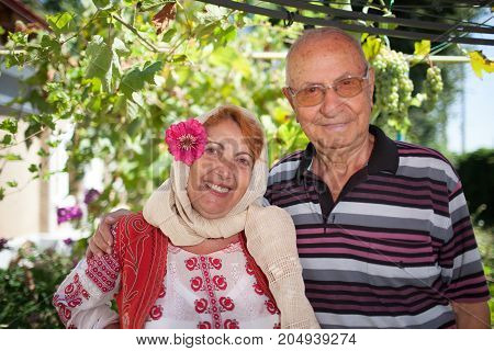 Romanian elder couple the woman dressed in Romanian traditional folk costume.