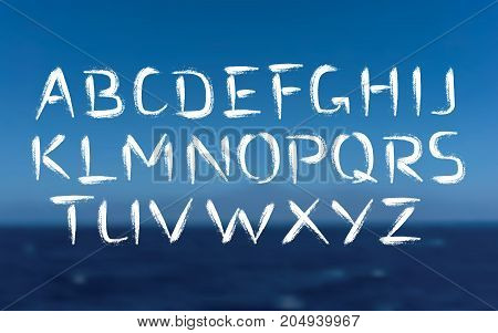 Vector Font. Brush strokes bold type. Grunge ABC on sea background. Painted letters design