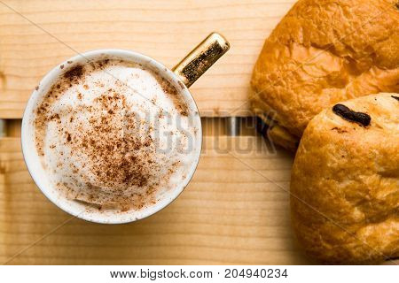 Light Morning Breakfast With Croissant And Coffee