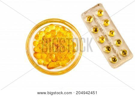Сapsules With Vitamins A And E. Yellow Capsuls In Glass Bowl And Blister With Capsules. Copy Space