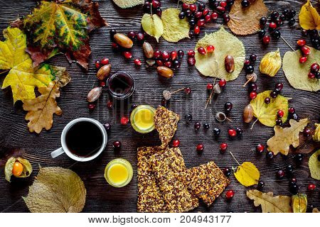 Autumn still life with honey and berries on wooden background.