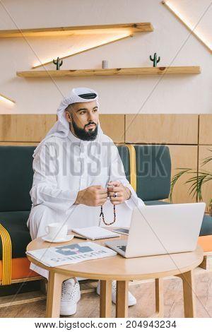 Muslim Businessman Sitting On Sofa